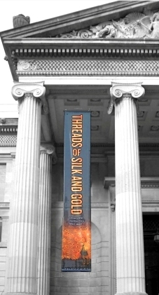 """""""Threads of Silk and Gold""""  advertising banner outside Ashmolean Museum, Oxford"""