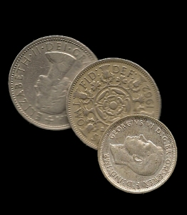 five shillings ( two florins and a one shilling coin)