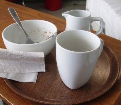 Empty cereal bowl and empty coffee mug