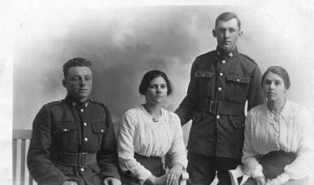 Two Canadian soldiers of the First World War with two young women.