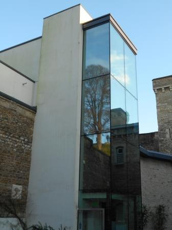 Oxford Castle Mound reflected in a window